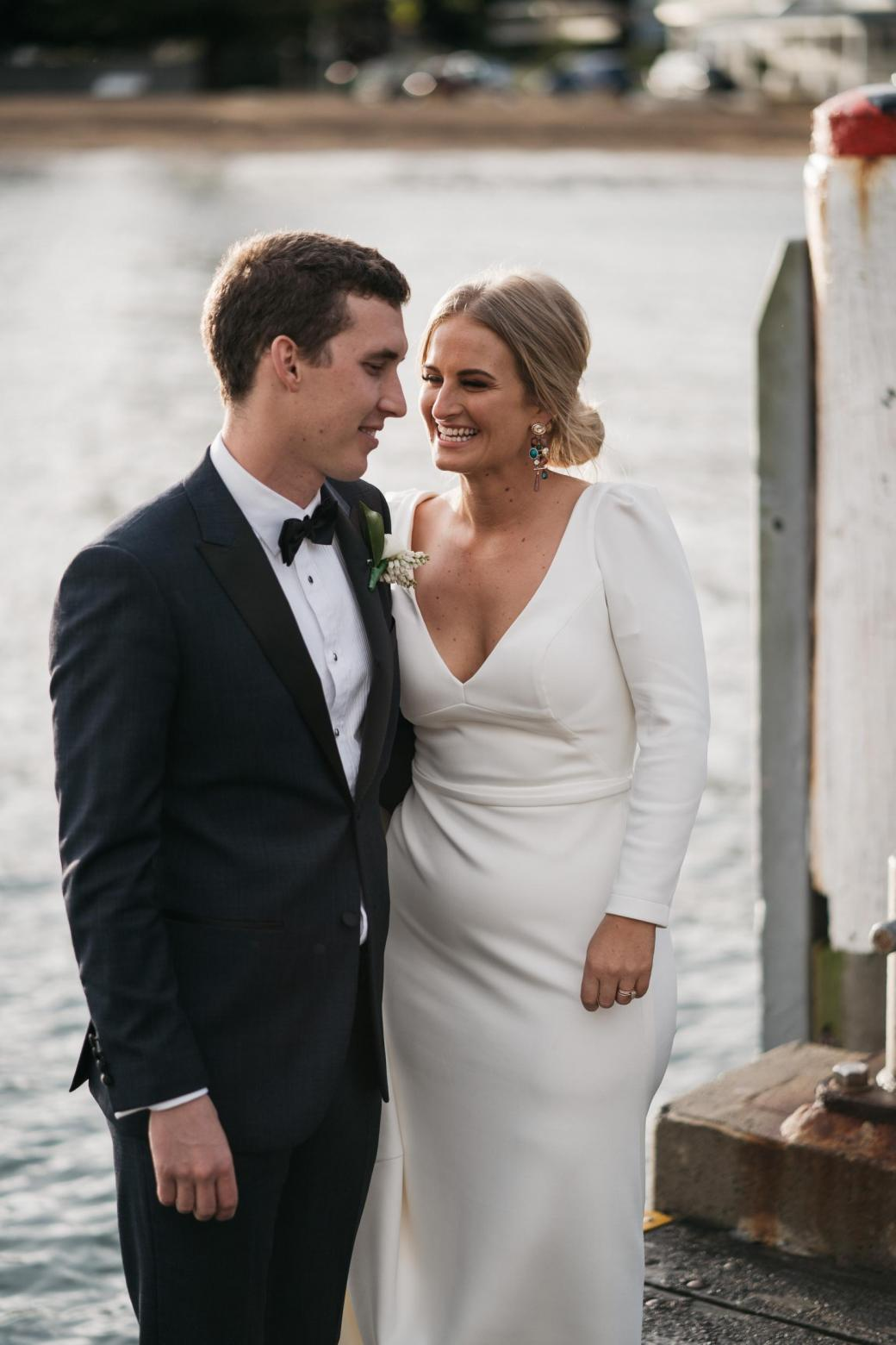 KWH bride Jordana with her new husband; wearing the AUBREY gown; a timeless long-sleeve wedding dress.